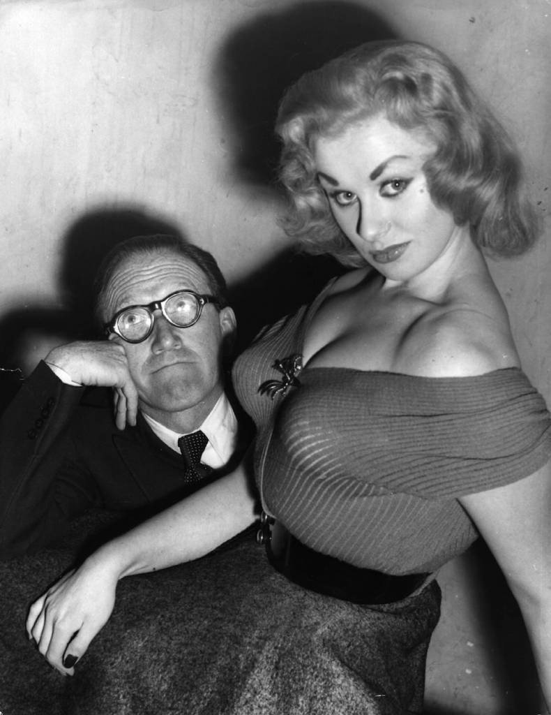 Glamour model and actress Sabrina seated on the knee of Arthur Askey. Original Publication: People Disc - HM0271 (Photo by Keystone/Getty Images)