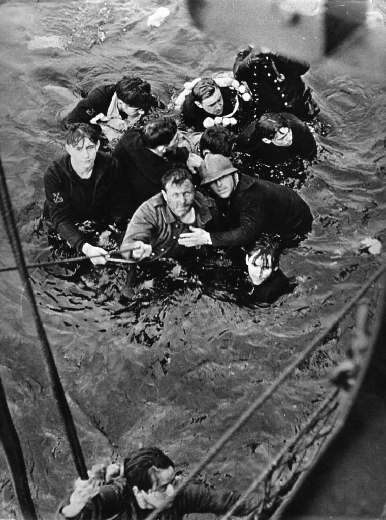 May 1940: A British ship rescues soldiers from a landing craft sunk during an operation.