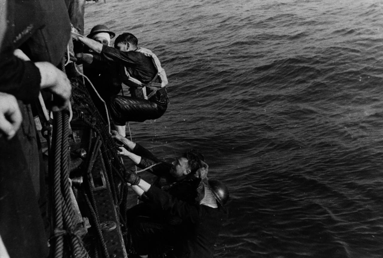 May 1940: A British ship rescues soldiers from a landing craft sunk during an operation. (Photo by Picture Post/Hulton Archive/Getty Images)