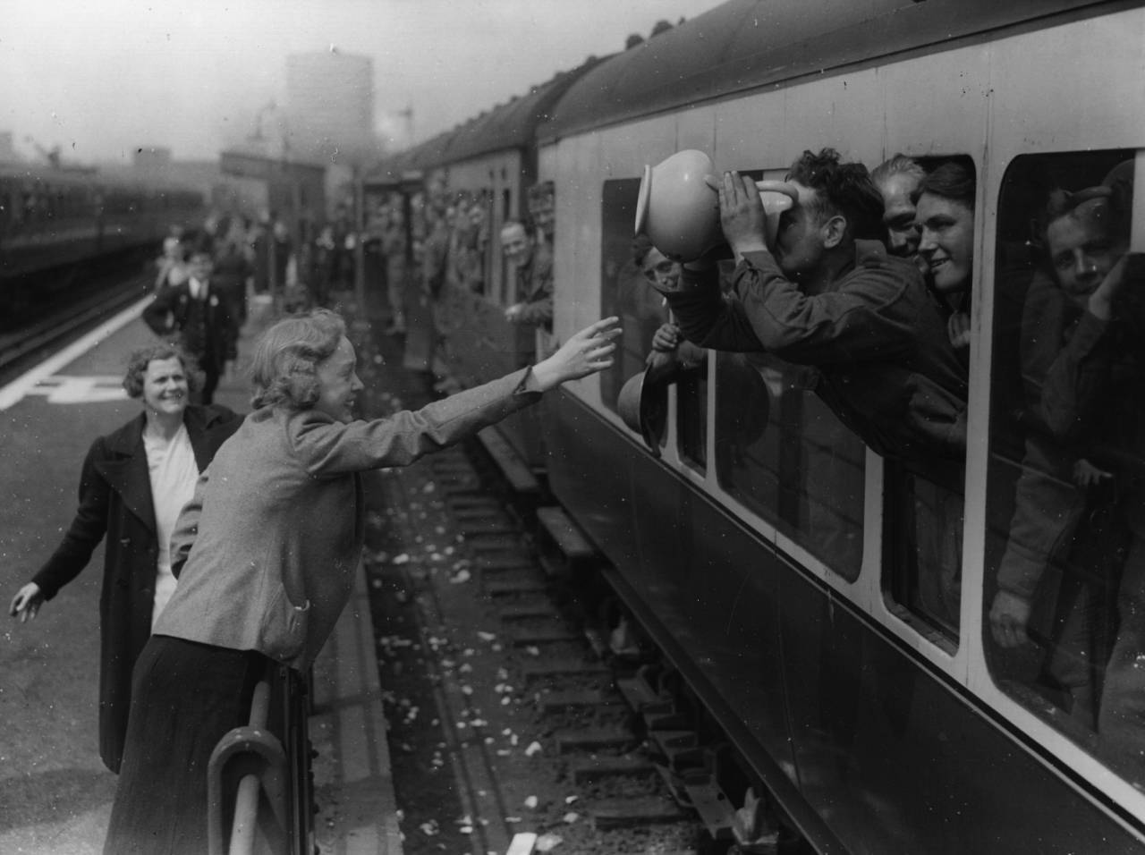 1st May 1940: A long drink for a member of the BEF at the end of his journey home from Dunkirk. (Photo by Topical Press Agency/Getty Images)