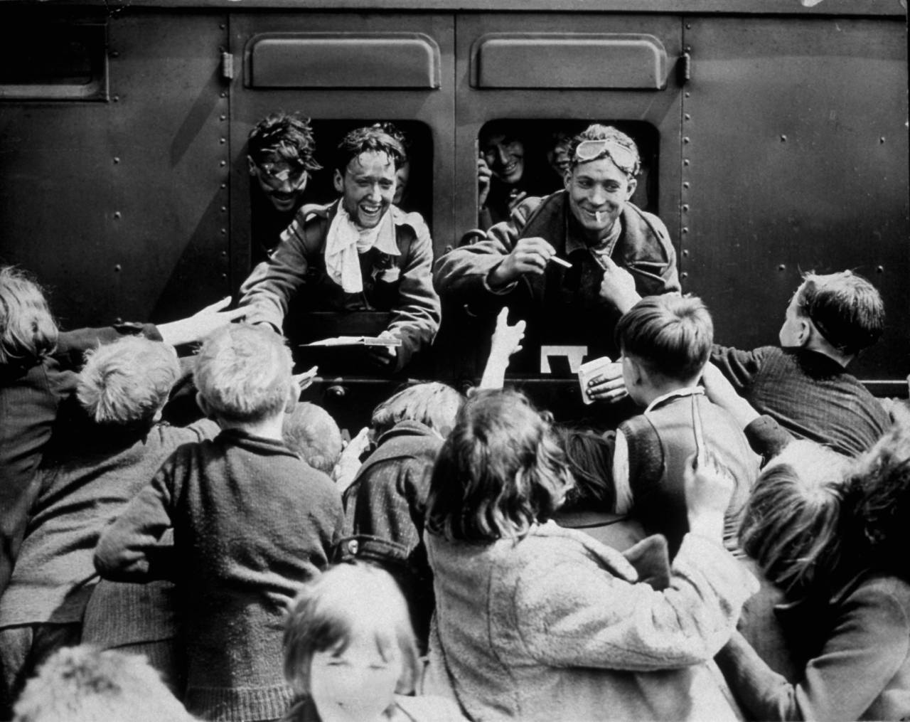 1940:  Children rush up to a train carrying BEF men back from Dunkirk.  (Photo by Hulton Archive/Getty Images)