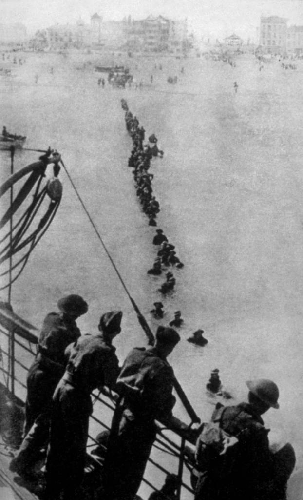 1940:  Up to their necks in water, retreating soldiers have to struggle through the sea because the waiting ships could not get closer to the Dunkirk beach.  (Photo by Bert Hardy/Keystone/Getty Images)