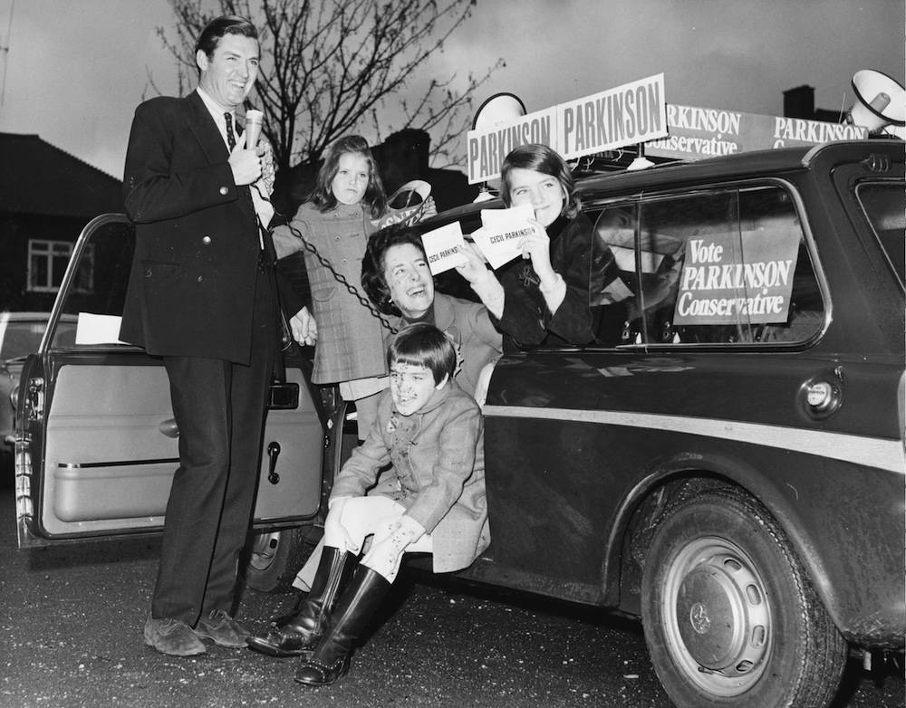 British politician Cecil Parkinson, the Conservative and Unionist Party Candidate for Enfield West, posing in with his family whilst campaigning for votes, Enfield, London, November 12th 1970. (Photo by Fox Photos/Hulton Archive/Getty Images)