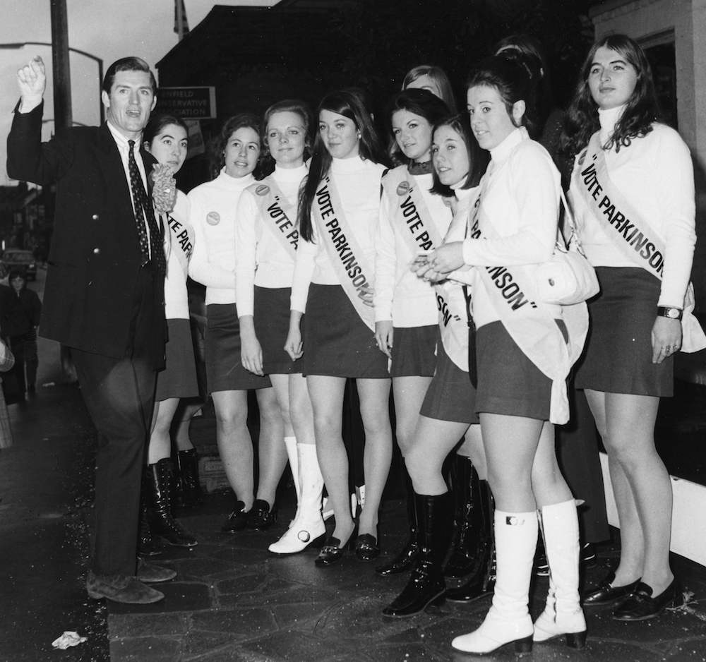 British politician Cecil Parkinson, the Conservative and Unionist Party Candidate for Enfield West, briefing a group of his campaign girls whilst on an election tour, London, November 12th 1970. (Photo by Fox Photos/Hulton Archive/Getty Images)