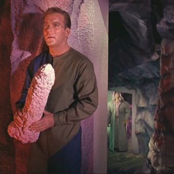 Captain Kirk grabs the phallic cave rock