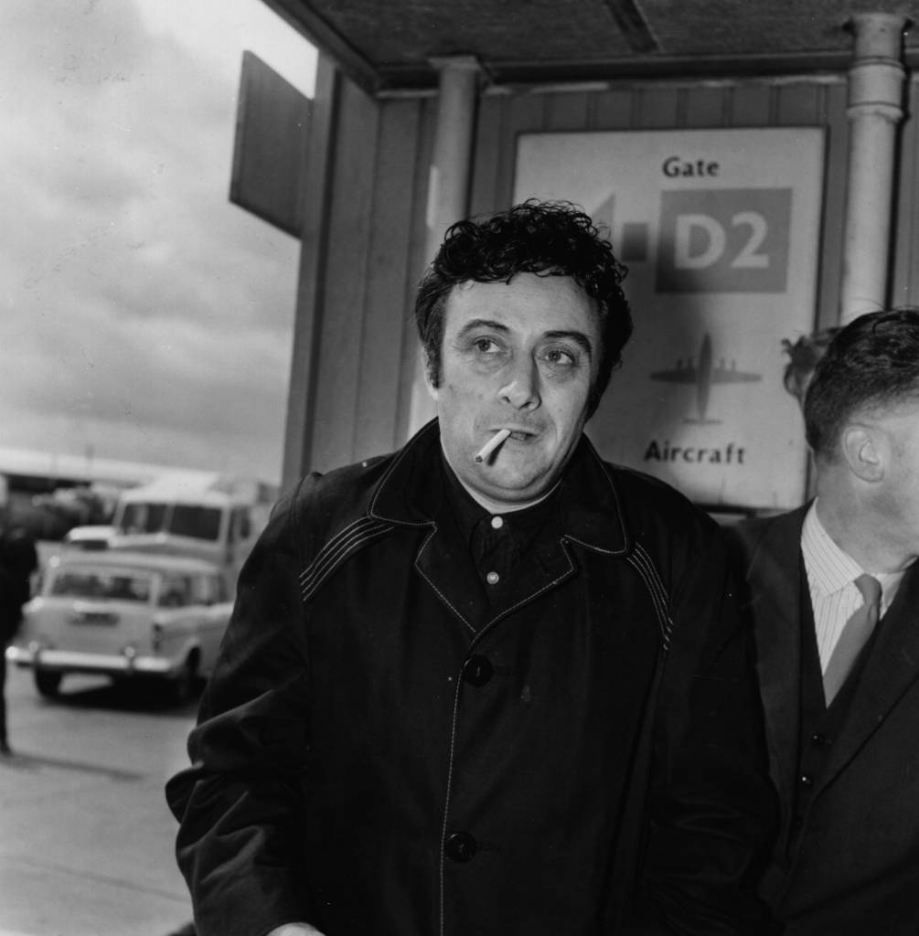 American comedian Lenny Bruce (1926 - 1966) at London Airport.    (Photo by Dove/Getty Images)