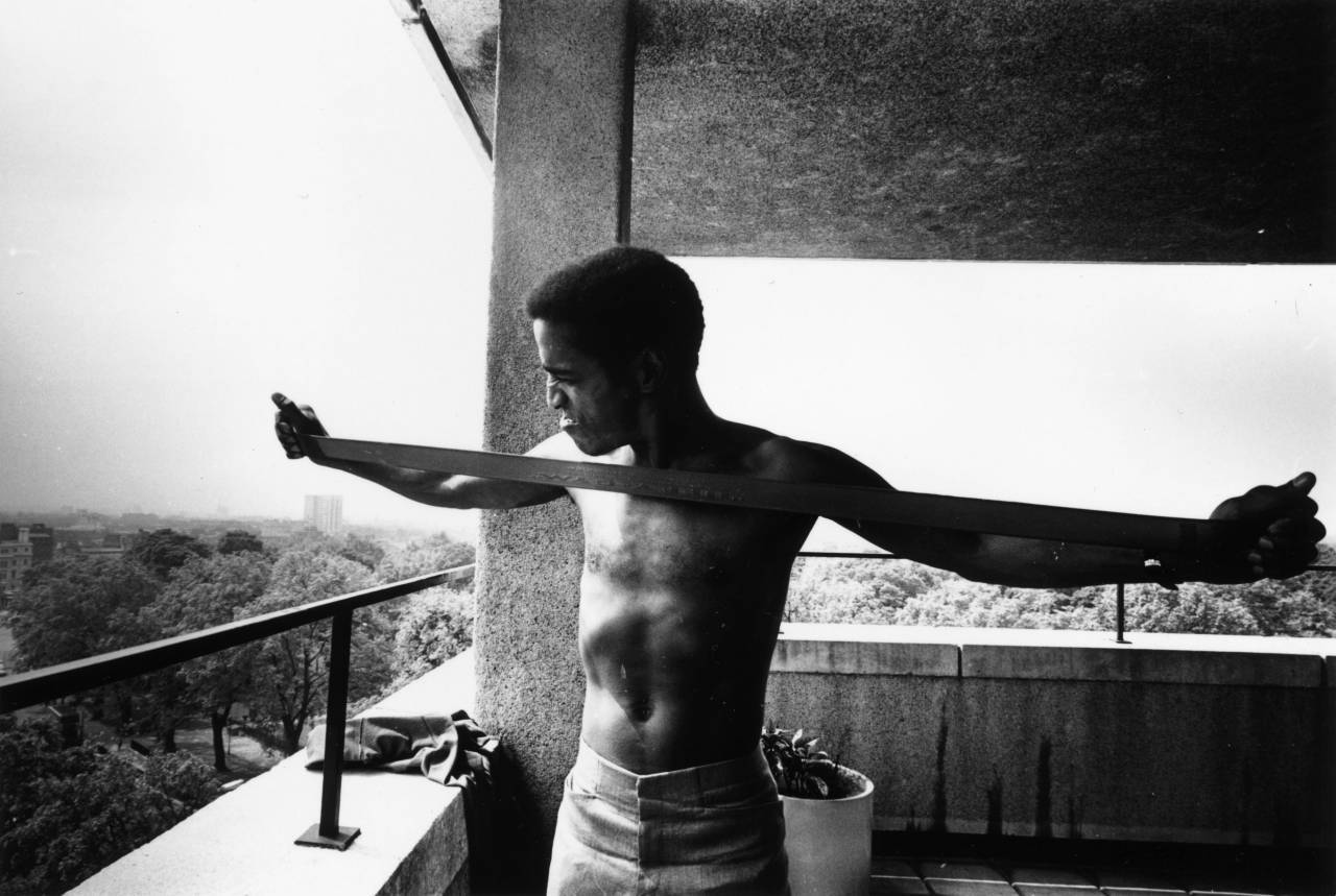 June 1968: American actor, singer and dancer Sammy Davis Jnr (1925 - 1990) keeping in trim with an elastic chest expander or 'Jiffy-Gym'. (Photo by Evening Standard/Getty Images)