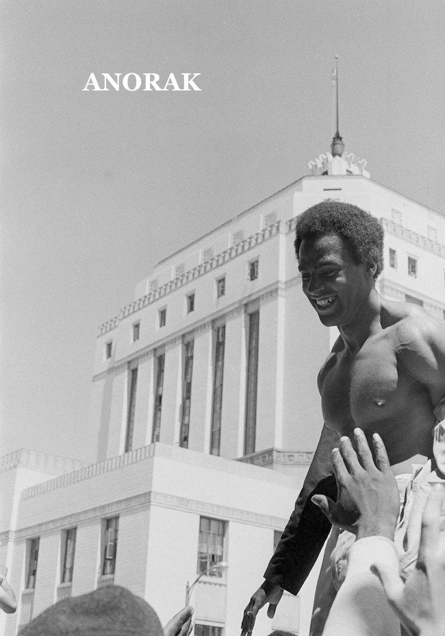 Stripped to the waist in the afternoon sun, Huey Newton, co-founder of the Black Panthers shakes hands with followers and friends who greeted him as he walked out of the Alameda County Courthouse in Oakland, Calif., Aug. 6, 1970.