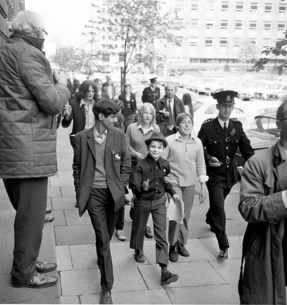Children including a very rude boy marching towards County Hall