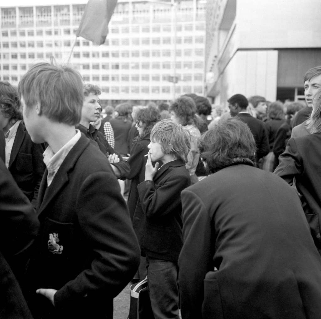 A schoolboy smokes as a 'pupil power' demonstration breaks up near County Hall following a rally in Hyde Park. A letter was handed in demanding an end to compulsory wearing of school uniform, caning and detention.