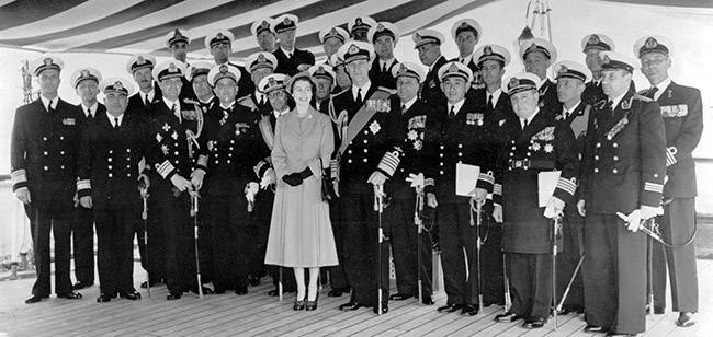 The Queen and the Duke of Edinburgh with officers commanding foreign warships, whom her Majesty received aboard the Royal yacht, the dispatch vessel Surprise, before leaving Portsmouth for the Coronation Naval review at Spithead.