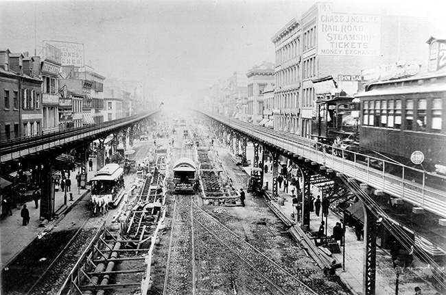 This is a general view of the Third Avenue Line El train tracks, looking north up the Bowery from Grand Street, in New York City, 1891. Note the cable car tracks being installed on the west side of the street. (AP Photo)