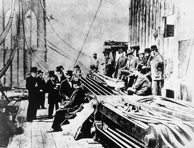 Engineers and trustees of the Brooklyn Bridge are shown on the bridge during construction circa 1880 in New York City. The bridge opened to traffic in 1883. (AP Photo)