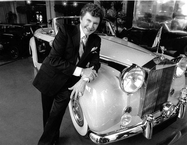 Liberace poses with a one-of-a-kind 1956 Rolls-Royce Silver Cloud I on Feb. 21, 1985 which he will use during his Radio City Music Hall show in April. Reportedly the most valuable Rolls-Royce, the car was originally designed for Elizabeth Taylor. (AP Photo/Marty Lederhandler)