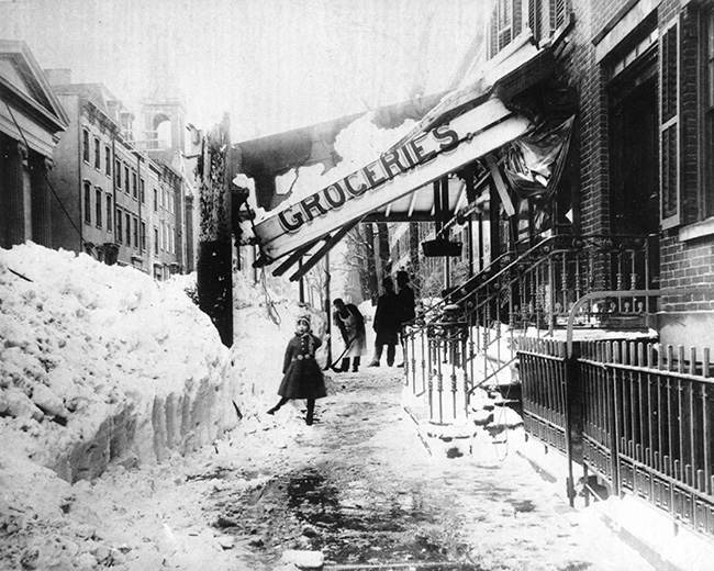 The awning of a grocery store is damaged from the weight of the snow during the blizzard of 1888 in New York City. The blizzard on March 12-14 paralyzed the city with about 40