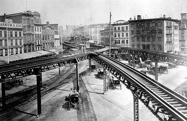 This is an 1878 view of the Third Avenue Line El train tracks, looking north up the east side of the Bowery, at Chatham Square in lower Manhattan, New York. (AP Photo)