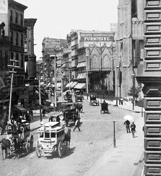 This photo shows Broadway, looking north from 10th Street, and Grace Church, right, in New YorK City circa 1880s. (AP Photo)