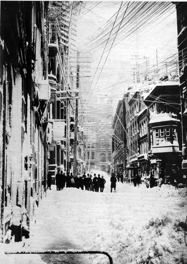 A New York street is shown during the blizzard of 1888. The blizzard that occured March 12-14 paralyzed the city with 40