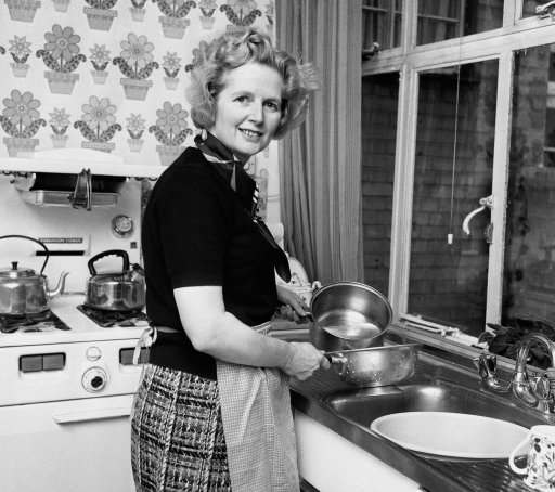Conservative party leader Mrs Margaret Thatcher in her Chelsea home kitchen.