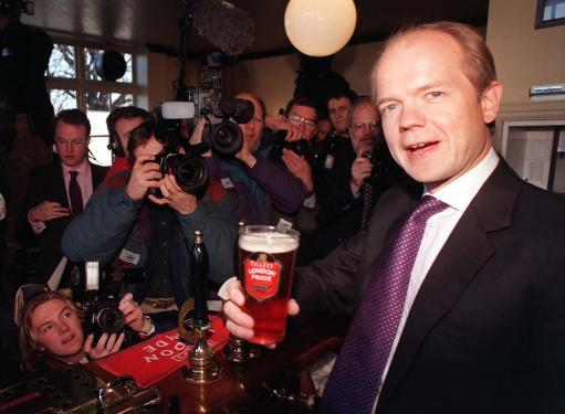 Conservative Party leader William Hague publicly samples a pint
