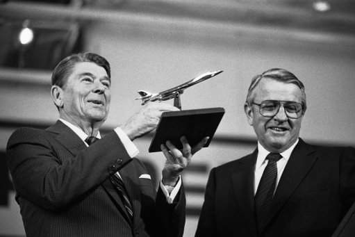 President Ronald Reagan looks at a model of the B-1B bomber presented him after he toured the Palmdale Aircraft Assembly Plant on Monday, Oct. 22, 1984 in Palmdale where the B-1B bomber is being assembled. (AP Photo)
