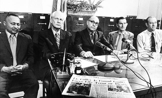 """These five members of the Clarke County Selective Service Board pose in Athens, Ga., March 30, 1971, after announcing their resignations in protest of Lt. Williams Calley's conviction at Ft. Benning, Ga. From left to right are John Nelly, Daniel B. Amaker, George H. Pugh, Roscoe Hansfort and William F. Condon. The letter of resignation said, """"We find the conviction of Lt. Calley to be unacceptable and cannot in good conscience continue to make decisions that will effect the lives and well-being of our young men."""" (AP Photo)"""