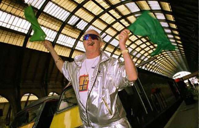 """Jimmy Savile, former """"Jim'll Fix It"""" presenter, celebrates Great North Eastern Railways' (GNER first birthday, by launching its new high speed train at Kings Cross Station today (Monday)."""
