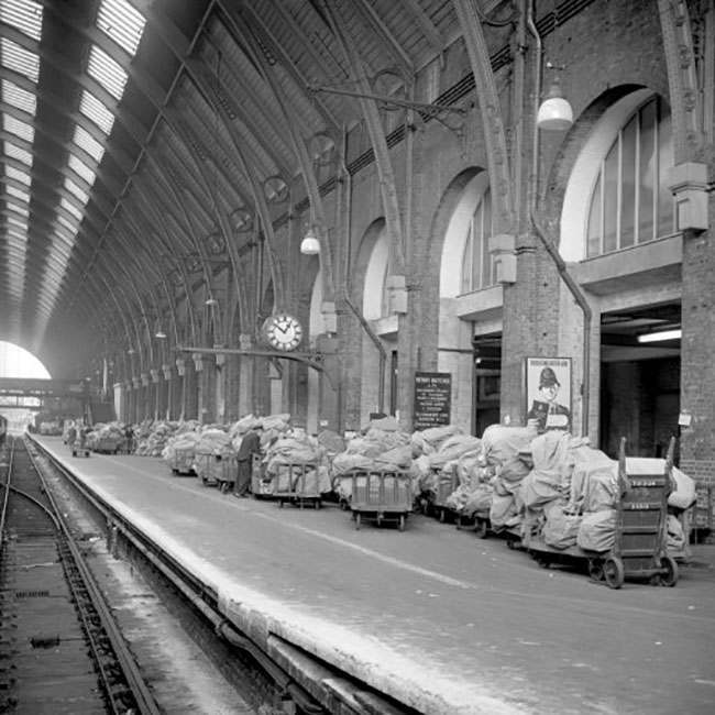 Trolleys laden with bags full of letters and parcels await collection at King's Cross Station, London by Post Office vans, which are fewer than usual owing to the postal workers pay strike. Numbers of workers is down by about 10,000 following the strikes