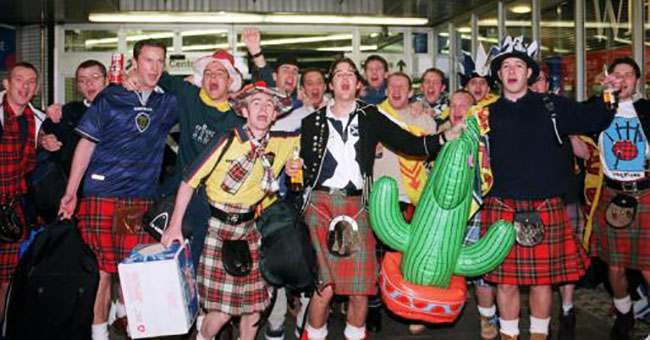 Scotland soccer fans arrive at Kings Cross station in the capital ahead of the Euro 2000 qualifier 2nd leg football match against England at Wembley stadium.