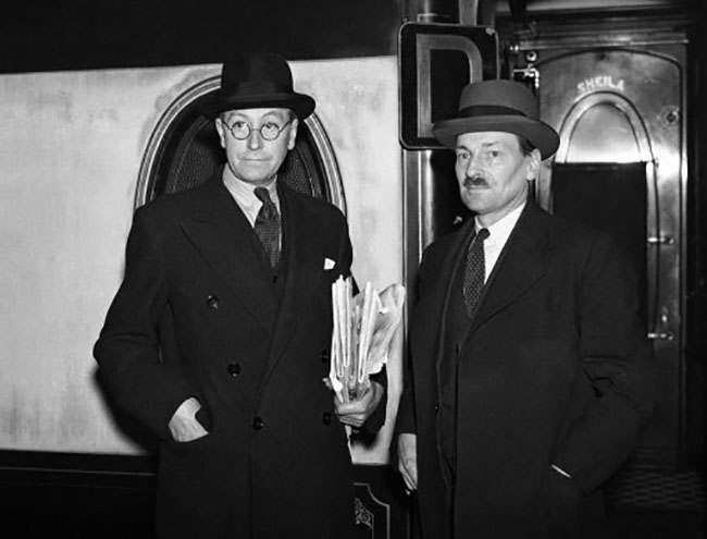 Arthur Greenwood, left, and Clement Atlee at King's Cross Station on their departure for Edinburgh after they had seen the Chancellor of the Exchequer, in London, on Oct. 8, 1936. (AP Photo)