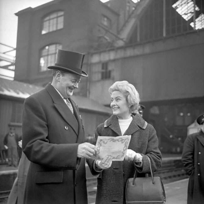 Nottinghamshire businesman Alan Pegler and his wife (name not known), look on proudly at the certificate of ownership for the legendary steam-locomotive The Flying Scotsman. Mr Pegler purchased the engine for £3,000 when British Rail announced it was not intending to preserve any of the Pacific Class locomotives, despite their historical importance.