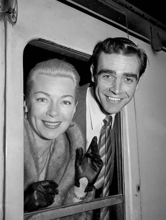 """Actor Sean Connery and actress Lana Turner who are appearing together in the film  """"Another Time Another Place"""", arriving at London Kings Cross Station."""