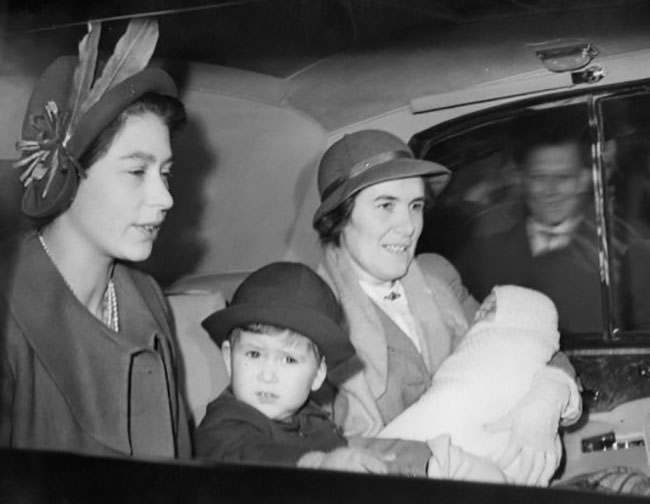 Princess Elizabeth, her two children Prince Charles and Princess Anne, and Princess Margaret arrive in London from Scotland after their Deeside holiday. The baby Princess Anne is carried by nurse Lightbody, with Prince Charles seated beside Princess Elizabeth. The Royal car is seen leaving King's Cross Station, London. *Low-res scan - Hi-res scan on request