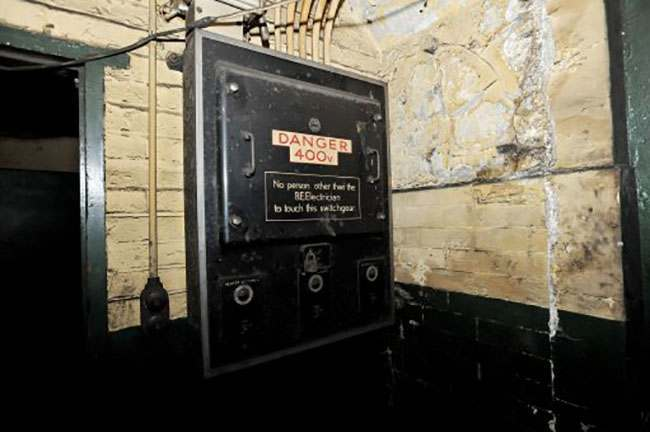 EMBARGOED TO 0001 AUGUST 7. A view of a Royal Engineers switchgear box inside the former Brompton Road tube station, a disused station on the Piccadilly line between South Kensington and Knightsbridge which is owned by the Ministry of Defence and which has been put on the property market.