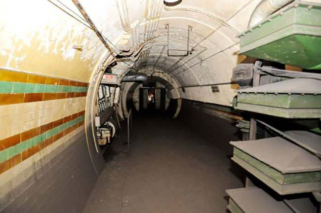 EMBARGOED TO 0001 AUGUST 7. A view inside the former Brompton Road tube station, a disused station on the Piccadilly line between South Kensington and Knightsbridge which is owned by the Ministry of Defence and which has been put on the property market.