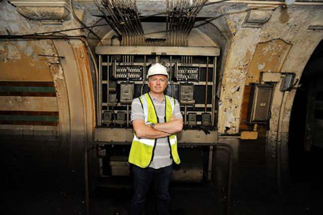 EMBARGOED TO 0001 AUGUST 7. Ministry of Defence property surveyor Julian Chafer, stands in front of switch and fuse boxes in the former Brompton Road tube station, a disused station on the Piccadilly line between South Kensington and Knightsbridge which is owned by the Ministry of Defence and which has been put on the property market.