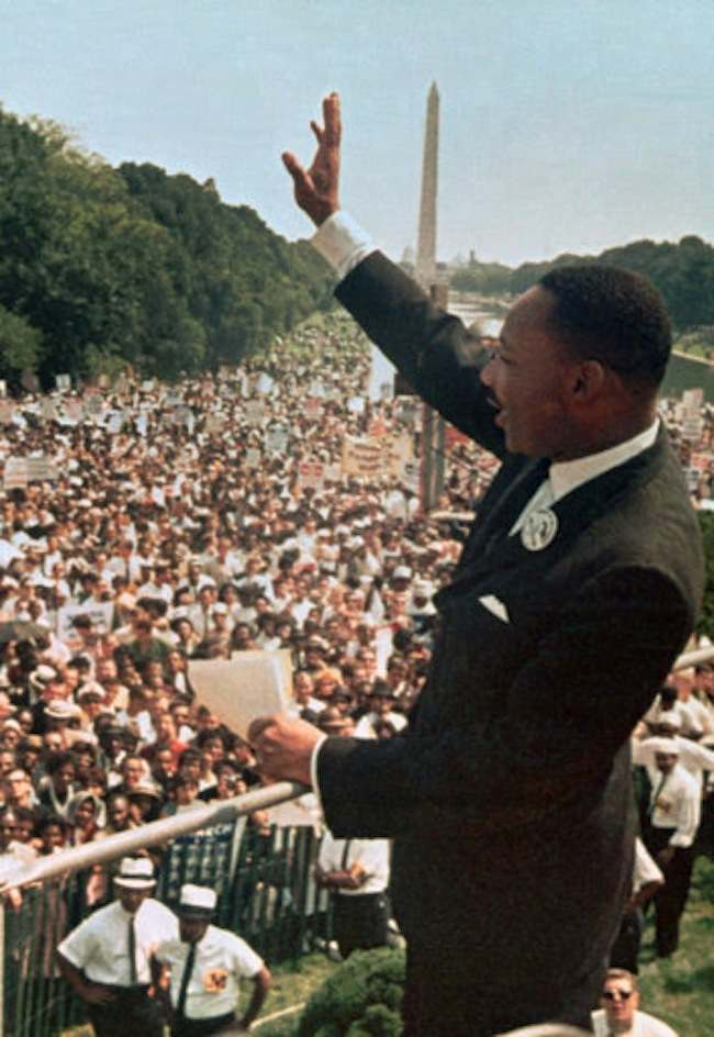 "FILE - This Aug. 28, 1963, file photo shows Dr. Martin Luther King Jr. acknowledging the crowd at the Lincoln Memorial for his ""I Have a Dream"" speech during the March on Washington. Next Wednesday, the nation's first black president will stand near the spot where Martin Luther King Jr. stood 50 years ago, a living symbol of the racial progress King dreamed about, and enunciate where he believes this nation should be headed. (AP Photo/File)"