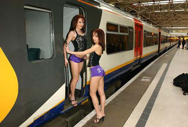 """The Cheeky Girls at the launch of the new """"2-1"""" rail initiative, at Kings Cross Station, London. The scheme, backed by the 12 London rail companies and the Mayor's """"Totally London"""" campaign, offers travellers 2 for 1 rail fares and entry to some of London's top attractions."""