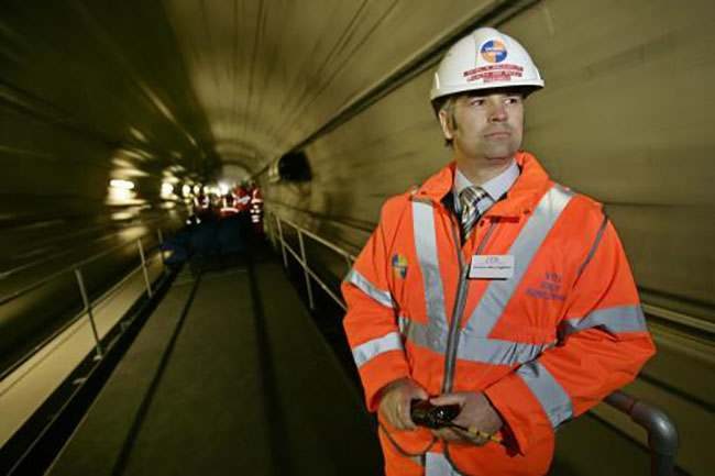 Charlie McLaughlin, health and safety manager of one of the contractors of the newly-completed Stratford international train station checks a tunnel aboard a train, in east London, Thursday April, 20, 2006. The station will join to the Channel Tunnel rail service that links London with Paris and Brussels and will also ferry passengers in seven-minute journeys between the 2012 Olympic site and Kings Cross station in central London. The International Olympic Committee's Coordination Commission are visiting London to receive the first reports on preparations for the 2012 London Games and to visit games-related sites. (AP Photo/Lefteris Pitarakis)