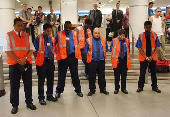 London Underground staff and commuters stop for a two minutes silence in Kings Cross Tube station, London, as the capital remembers last years terrorist bombings.