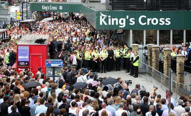 A two minute's silence is observed at Kings Cross Tube station, London, as the capital remembers last years terrorist bombings.