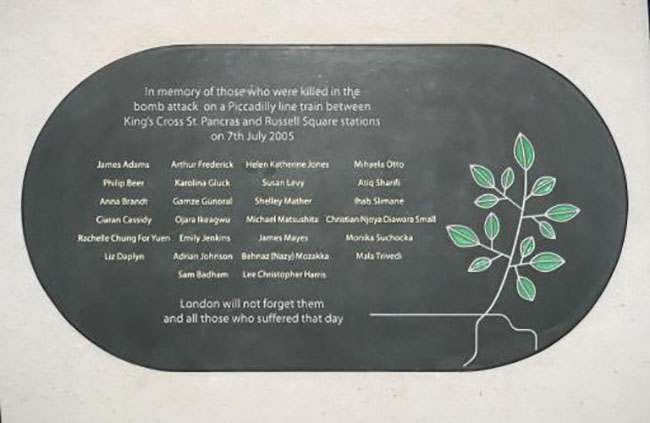 King's Cross station memorial plaque, which names all the commuters who lost their lives on 7/7/2005 during Londons terrorist attacks.