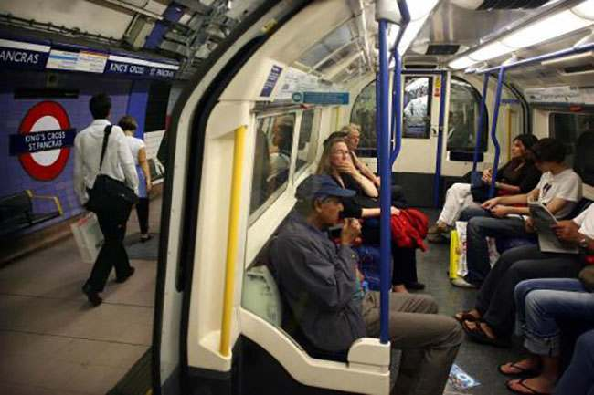 A London Underground train pulls into Kings Cross Station.