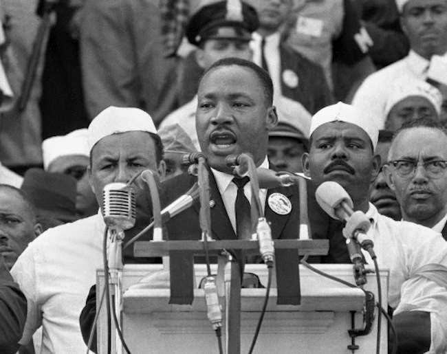 "** -- FILE ** In this Aug. 28, 1963, black-and-white file photo Dr. Martin Luther King Jr., head of the Southern Christian Leadership Conference, addresses marchers during his ""I Have a Dream"" speech at the Lincoln Memorial in Washington. The 45th anniversary of the iconic leader's most memorable speech coincides with the day when another African-American leader, Barack Obama, is scheduled to makes a historic speech of his own _ accepting the Democratic Party's nomination for president of the United States Aug. 28, 2008, in Denver, Colo. (AP Photo/File)"