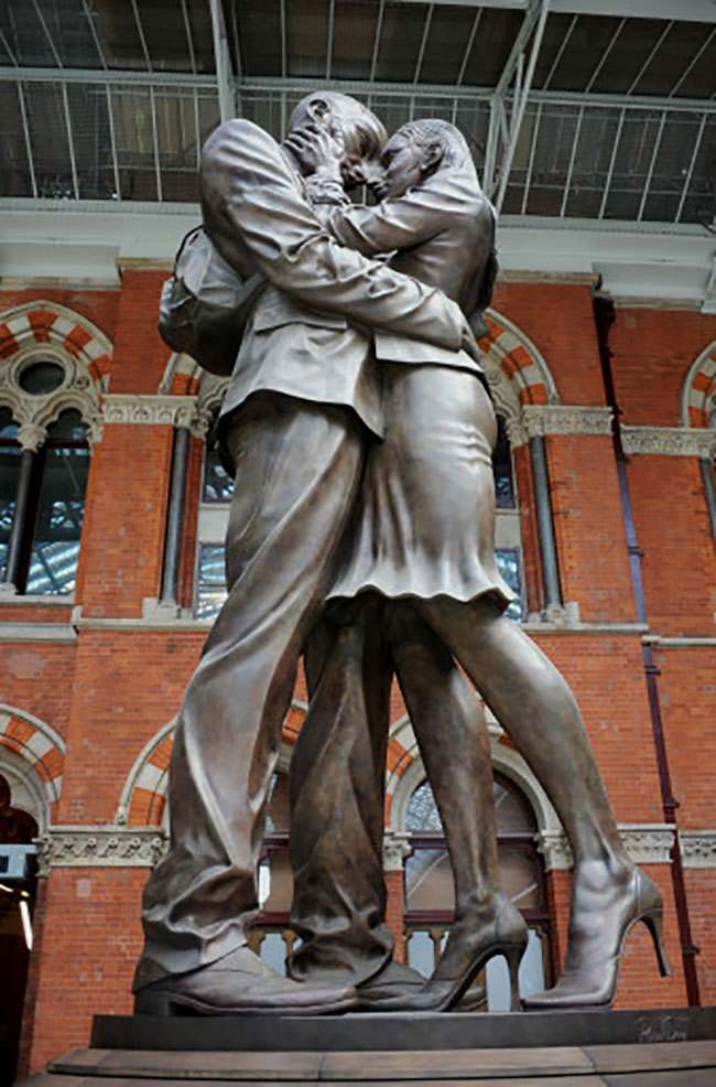 Stock: The Meeting Place, a 30ft high bronze statue by British artist, Paul Day, that stands in London's St Pancras Station.