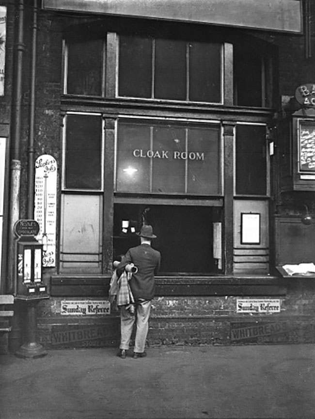 A man stands outside King's Cross station cloakroom, London, England, Tuesday, June. 19, 1934. It was at this location that a suitcase containing a pair of legs was discovered. Mysteriously, the dismembered body of a woman was also found at Brighton railway station yesterday. (AP Photo)