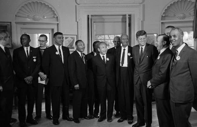 **ADVANCE FOR THURSDAY, FEB. 12** In this Aug. 28, 1963 file photo, President Kennedy poses at the White House with a group of leaders of the March on Washington. From left, Whitney Young, National Urban League; Dr. Martin Luther King, Christian Leadership Conference; John Lewis, Student Non-violent Coordinating Committee; Rabbi Joachim Prinz, American Jewish Congress; Dr. Eugene P. Donnaly, National Council of Churches; A. Philip Randolph, AFL-CIO vice president; Kennedy; Walter Reuther, Unidted Auto Workers; Vice-President Johnson, rear, and Roy Wilkins, NAACP. (AP Photo, file)