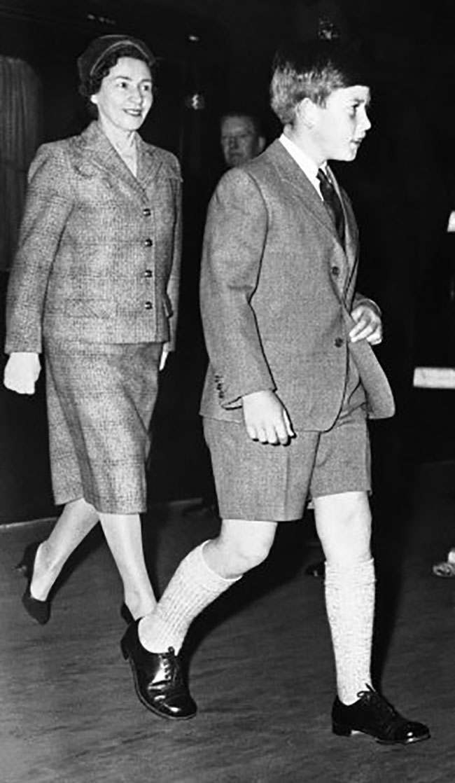 The Prince of Wales, who is large for his age - he'll be 11 on Nov. 14 - wears schoolboy shorts as he walks through London's King's Cross station, Sept. 21, 1959, on his way to boarding school. Behind him is his governess, Catherine Peebles. Standard practice at most British boarding school is for boys to wear shorts until they are 13 years old no matter how big they get. (AP Photo)