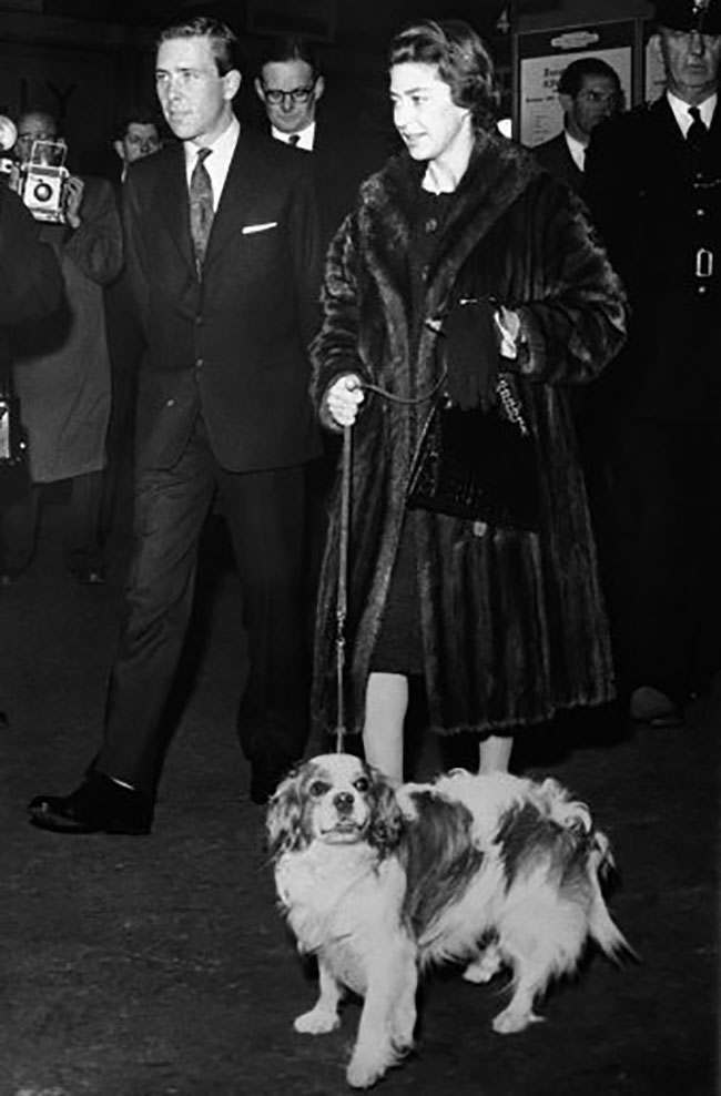 Mink-coated Princess Margaret and her husband, Antony Armstrong-Jones, walk through London?s Kings Cross railway station on their return on Sept. 24, 1960 from summer vacation on the royal Balmoral Estate in Scotland. The princess holds her King Charles spaniel on a leash. (AP Photo)