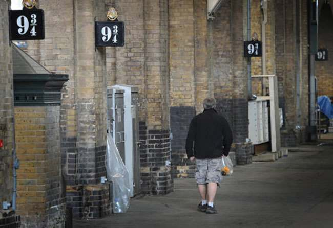 A platform at Kings Cross Station in London as it is transformed into Platform 9 3/4 during filming of the latest Harry Potter film.